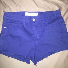 Blue high-waisted A&F shorts High-rise, cut-off shorts with slight distressing (comes up just below belly button). Size 2/26 in but I think it would fit a 4 as well because it's a pretty stretchy (denim) material. NWOT, ripped off the tag thinking I would wear them but the cut-off style doesn't look good on me :( color is royal blue (closest to first pic) Abercrombie & Fitch Shorts Jean Shorts