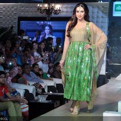Actress Karishma Kapoor walks the ramp in green and golden attire at the launch of real estate project Monarch Universal, held at Navi Mumbai.