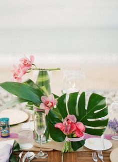 #orchids #tropical #centerpieces Photography by lexiafrank.com Floral Design by stem-pr.com  Read more - http://www.stylemepretty.com/2013/06/24/vieques-island-puerto-rico-wedding-from-lexia-frank-photography/