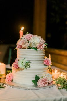 Pink and white wedding cake idea - classic two-tier wedding cake with pink and ivory roses {Foto By Freas Photography}
