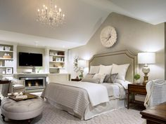 Candice knows how to spark a flame in the bedroom. She recommends starting with a soothing color palette paired with the right amount of soft lighting to create a restful sanctuary. A built-in fireplace and massive crystal chandelier enhance the room's romantic feel while an oversized, upholstered headboard takes advantage of the soaring vaulted ceiling.