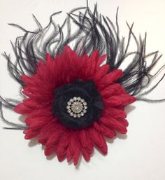 Fancy Girl Black Feather Burgundy Flower Hair Clip. Handmade by FancyGirlBoutiqueNYC  Buy it on Esty. Dance Competition.