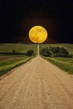 Super-moon rises over road to nowhere in eastern South Dakota, USA
