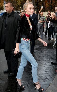 Lily-Rose Depp | stonewashed jeans + platform sandal heels + black cropped jacket + patterned strapless top + red neckerchief