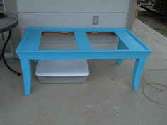 The sand and water table we made from a re-purposed coffee table