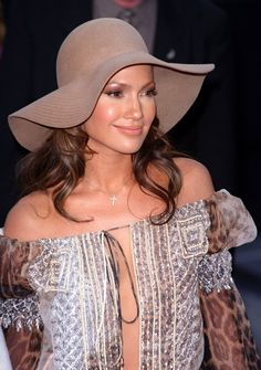 Pin for Later: 25 Times We Envied Jennifer Lopez's Beauty and Her Hot Body  Jennifer, pictured here at the 2001 MTV Video Music Awards, helped make floppy hats a thing.