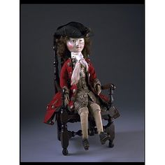 From the V&A. Lord Clapham offers a fine example of both formal and informal dress for a gentleman in the 1690s. His formal outfit includes a coat, waistcoat and breeches, while his informal dress is represented by the nightgown. Accessories such as the stockings, stock (a form of stiff, close-fitting neckcloth) and gloves are very valuable since very few items from this early period survive in museum collections.
