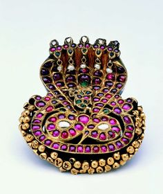 Gold cobra-head braid ornament (nagar) set with rubies, emeralds, diamonds, and pearls South India; 18th century