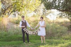Vista West Ranch Wedding, bride and groom portraits, fun wedding photography, natural light, rustic wedding, barn wedding, austin wedding photography, short wedding dress, newsboy cap, mr. and mrs. banner, holding hands