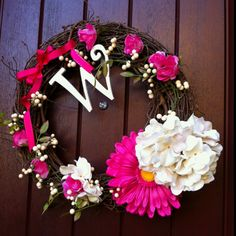 Spring door wreath--- i really pinned this just because it has my initial on it! Lol
