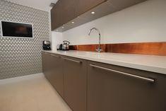Matt grey kitchen with copper backsplash