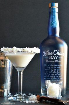 Coconut Cream Martini -  1 oz Blue Chair Bay Coconut Rum 2 oz half and half ¼ tsp vanilla Honey and coconut flakes for garnish (opt)