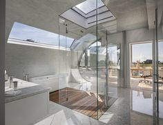 """The swoopy master bathroom, at the east end of the house, makes the whole building """"spatially more interesting,"""" says Bohlin. An all-glass shower stall culminates in a skylight. Hamptons House, The Hamptons, Modern Bathroom, Master Bathroom, Bathroom Ideas, Bathroom Renovations, Shower Ideas, Long Island House, Modern Daybed"""