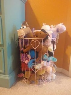 Simple stuffed animal storage idea -- use a wire basket or hamper {featured on Home Storage Solutions 101}