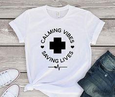 Calming Vibes Saving Lives T-Shirt Calming Vibes Shirt Nurse Shirt Doctor Shirt Attendant Shirt Therapist Shirt Inspirational Shirt - - Tee Shirts, Tees, Nursing T Shirts, Funny Nursing, Nursing Tops, Nursing Memes, Band Shirts, Shirt Designs, Nurse Quotes