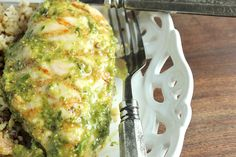 Bright green homemade pesto makes a lovely marinade for grilled chicken for a flavorful summertime dinner perfect for a lazy weeknight.
