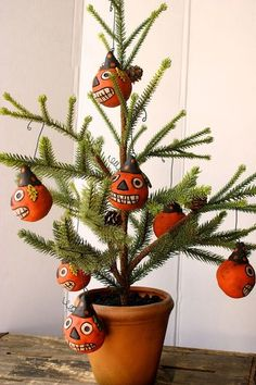Halloween pumpkins made from oven baked clay and added to a cute tree