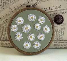 Embroidered Daisy Wall Hanging by HandmadeandHeritage on Etsy