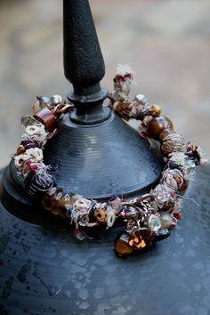 """Wrapped In Silk Bangle Bracelet""  Deryn Mentock  sterling, silk, textiles, stones, crystals, bone, glass"