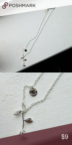 Rose drop with k initial necklace A super cute and dainty necklace that has a rose coming down at the end as a pendant and the letter K on the side. Brand new. Jewelry Necklaces