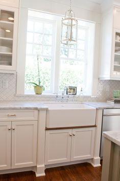 The Granite Gurus: Carrara marble Kitchen.   I love the millwork on sinkbase