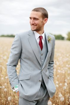 Handsome groom in a light grey 3-piece suit with a cranberry tie. #wedding #fashion