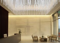 Paul Nulty Lighting Design - Private Airline Lounges - Reception Space Feature Bespoke Chandelier