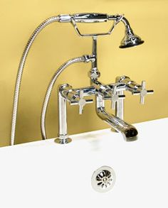 """Contemporary Deck Mount Tub Faucet with Hand Shower - Cross Handles  The modern design of this deck mount faucet features cylindrical cross handles and a sleek metal hand shower. This faucet fits easily on most tub rims and is available in a variety of finishes.    $450    Product Details   •  Solid brass construction.    •  1/4 turn ceramic disc valves.    •  7"""" centers.    •  Includes faucet, deck mount couplers, hand shower, cradle and 5' hose.    •  Faucet stands 13-3/4"""" tall and extends…"""