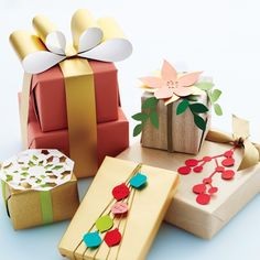 Who needs patterned gift wrap? Adorning boxed presents with winsome paper, pipe cleaners, and washi-tape tags and toppers in playful configurations makes what's outside the boxes as delightful as what's inside!