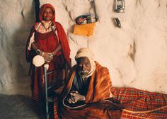 A Berber couple of Chenini, Tunisia in their traditional home