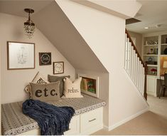A cozy reading nook for kids was cleverly created under the basement stairs complete Under Stairs Nook, Loft Stairs, Basement Stairs, House Stairs, Basement Ideas, Basement Carpet, Walkout Basement, Basement Bathroom, Bathroom Laundry