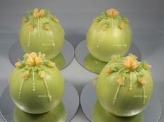 """Wedding bauble cakes. Frosting is Swiss meringue buttercream """"glazed"""" with translucent buttercream. Flowers are of translucent buttercream."""
