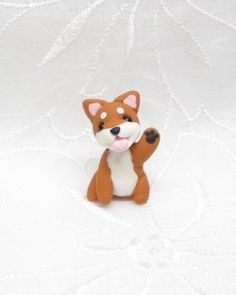 Hey, I found this really awesome Etsy listing at http://www.etsy.com/listing/157238380/petit-cute-japanese-shiba-inu-figure