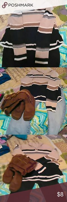 Beautiful clean sweater. Its stripped sweater, you can with brown boots, black boots, canvas tennis shoes. Looks great with brown or black corduories, jeans and a pair of leg Warners and a matching scarf and hat. 100% cotton so soft and warm for fall or winter. St. John's Bay Sweaters Crew & Scoop Necks