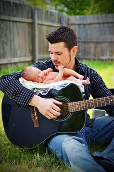 This pic is a must 4 our baby!!!! Tim n his guitar with the baby wld b absolutely adorable!!! Love it!