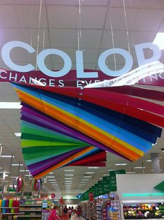 A great example of signage that could be installed with our Clik-Clik Magnetic Hanging System! Store Signage, Signage Display, Retail Signage, Environmental Graphics, Environmental Design, Rainbow Dash, Rainbow Colors, Gondola, Kid Character