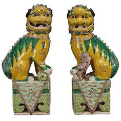 A Pair of Famille Jaune et Verte Foo Lions | From a unique collection of antique and modern animal sculptures at http://www.1stdibs.com/furniture/more-furniture-collectibles/animal-sculptures/