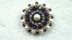 Beading4perfectionists : Wheel pendant with 6mm Swarovki pearls and bico...