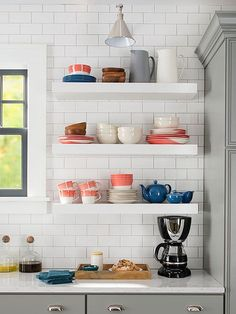 Add open storage in your kitchen by hanging floating shelves. Not only do shelves provide easy-access open storage, but they also create display space for cookbooks and decorative kitchen items. Easy Kitchen Updates, Updated Kitchen, Open Kitchen, Kitchen Dining, Kitchen Decor, Kitchen Paint, Kitchen White, Diy Kitchen, Shelf Design