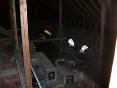 """When you know better you do better.  This is the attic on above the courtrooms and offices on the second third floor.  In the 1970's when the mechanical systems were updated, ceilings were lowered to """"save energy"""" and these wonderful arched transoms fell victim to modernization. Such a shame that no one can enjoy these windows from the inside with out a ladder."""