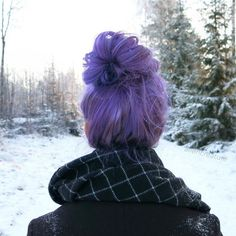 Lavender purple hair color with messy top bun, cute hairstyle
