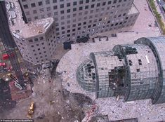 May of the photos document a desolate and apocalyptic view from overheard, showing once renowned tourist hot-spots, such as the Winter Garden Atrium (as shown), beaten, dust-clad and lifeless World Trade Center Nyc, Trade Centre, 11 September 2001, Woolworth Building, Monumental Architecture, North Tower, Ground Zeroes, Civil War Photos, Winter Garden