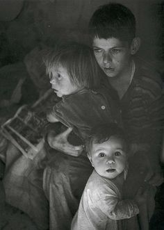Trailer Camp Children, 1944.  Photographed by Ansel Adams. (The portrait was taken while Adams was on assignment with Dorothea Lange for Fortune in San Joaquin Valley, California. The photograph was sold at Christie's in 2000 for 8225 USD.)