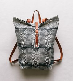 Easy to wear, good for overnight packing and large enough for a laptop or a few books, this printed backpack is ready for all sorts of everyday action. LOVE the pattern!!