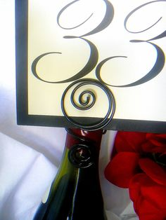 Wine Bottle Table Number Holders, Wedding Decorations, Wine Themed Bridal Showers, 25. $112.50, via Etsy.