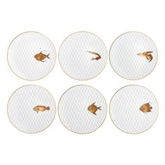 I love these limoges porcelain plates with goldleaf. The fish theme is perfect for a Pisces.
