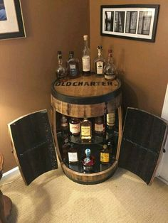 This was a custom request for a bourbon lovers birthday. Full barrel cabinet has TWO doors that open outward to reveal your private bourbon collection. An LED light illuminates the charred interior of the barrel and the glass shelves allow the light Small Liquor Cabinet, Drinks Cabinet, Tonneau Bar, Barris, Barrel Projects, Barrel Furniture, Furniture Ideas, Bourbon Barrel, Bourbon Whiskey
