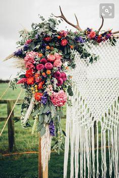 Want corner florals and cascading greenery on either side of the altar. Net necessarily in these colors or this large - a bit smaller please!