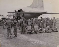 WWII: Flying ambulance - At the Japanese Yontan air field on Okinawa wounded Marines are loaded into a hospital transport plane for evacuation to rear base hospitals. This strip was captured on the first day of the assault and was put to use for American planes shortly thereafter.