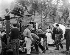 Gone with the Wind (1939) - Vivien Leigh with Thomas Mitchell, replaced director George Cukor walking alongside, cameras and technicians all around. Scene will be re-shot, when Cukor leaves production.